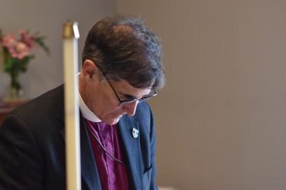 Bishop prayerfully considers placing his seal-DSC_6475